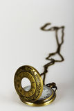 Pocket watch against a light background Stock Photos