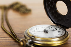 Pocket watch against a rustic background Royalty Free Stock Image
