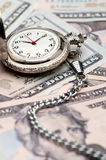 A pocket watch on American currency Royalty Free Stock Photo