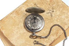 Pocket watch on ancient book Stock Photography