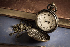 Pocket watch with antique book Royalty Free Stock Photo