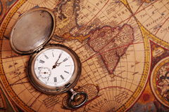 Pocket watch on antique map. Old silver pocket watch on antique map Stock Photography