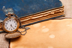 Pocket watch with antiquities Royalty Free Stock Image