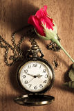 Pocket watch with artificial rose. Royalty Free Stock Photo