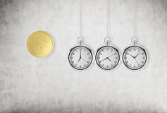 A pocket watch as a swing of the pendulum. A gold dollar coin as a first piece of a pendulum.  Stock Images