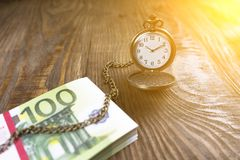 Pocket watch associated with cash in the tree. Time is money. Copy paste Stock Image