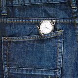 Pocket watch in a back pocket of a jeans Royalty Free Stock Photography