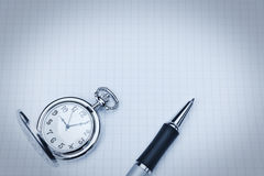 Pocket watch and ballpoint pen. Stock Photography