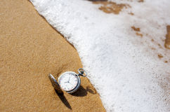Pocket watch on the beach Royalty Free Stock Images