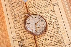 Pocket watch on the book Stock Images