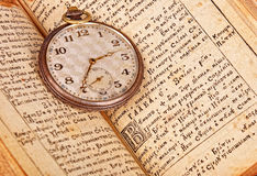 Pocket watch on the book Stock Photos