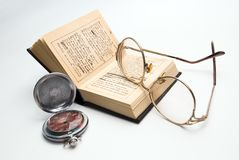 Pocket watch, book and glasses. Pocket watch, glasses and opened book Stock Photography