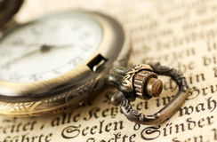 Pocket watch on book Stock Photo
