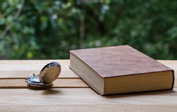 Pocket watch and the book stock images