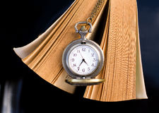 Pocket watch and book Stock Photos