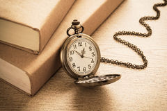 Pocket watch and books, vintage style Royalty Free Stock Photography
