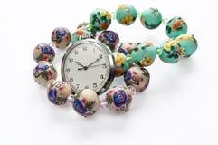 Pocket watch and bracelets. Isolated pocket watch and bracelets Stock Photos
