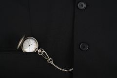 Pocket watch in a business suit Royalty Free Stock Photos