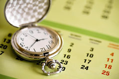 Pocket watch and calendar Stock Image