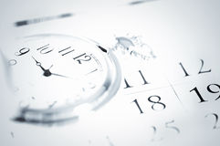 Pocket watch and calendar Stock Images