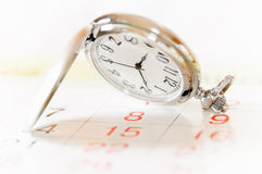 Pocket watch and calendar Stock Photo