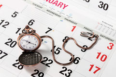 Pocket Watch on Calendar Royalty Free Stock Photography