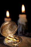Pocket watch and candles Royalty Free Stock Photos