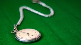 Pocket Watch with chain on green background stock photography