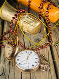 Pocket watch and champagne bottles stock photography
