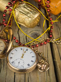 Pocket watch and champagne bottles Royalty Free Stock Image