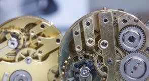 Pocket watch clockworks. Some plain pocket watch clockworks Royalty Free Stock Images