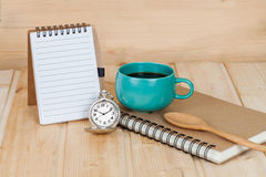 Pocket watch and coffee cup Stock Photos