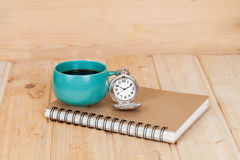 Pocket watch and coffee cup Stock Photo