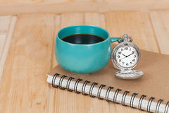 Pocket watch and coffee cup Stock Image