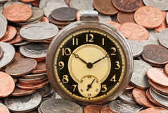 Pocket Watch on Coins Royalty Free Stock Image