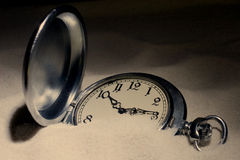 Pocket watch covered with sand Stock Photos