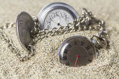 Pocket watch covered with sand. Stock Image