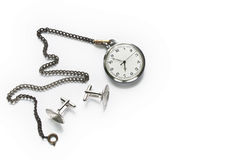 Pocket watch and cufflinks. Isolated pocket watch and cufflinks Royalty Free Stock Photos