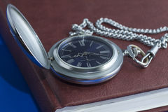 Pocket watch on diary page Royalty Free Stock Photo
