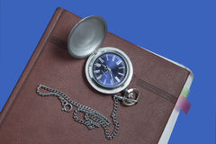 Pocket watch on diary page Royalty Free Stock Images