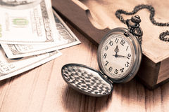 Pocket watch and dollar bills, vintage style Royalty Free Stock Photography
