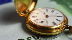 Pocket watch and euro banknote stock footage