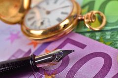 Pocket watch, euro bills and ink pen Stock Photography