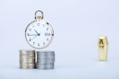 Pocket watch with European currencies and tomb Royalty Free Stock Photos