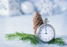 Pocket watch and fir tree branch on blue background Royalty Free Stock Photography