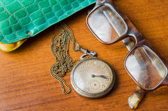 Pocket watch with glasses and  case Stock Photography
