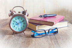 Pocket watch and glasses Royalty Free Stock Image