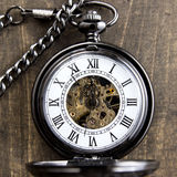 Pocket watch on grunge wooden table Royalty Free Stock Image