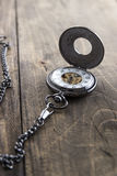 Pocket watch on grunge wooden table Stock Photo