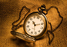 Pocket watch with gunny. The pocket watch with gunny Royalty Free Stock Photo